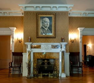 photo of copper baron marcus daly on the mantle at daly mansion hamilton montana