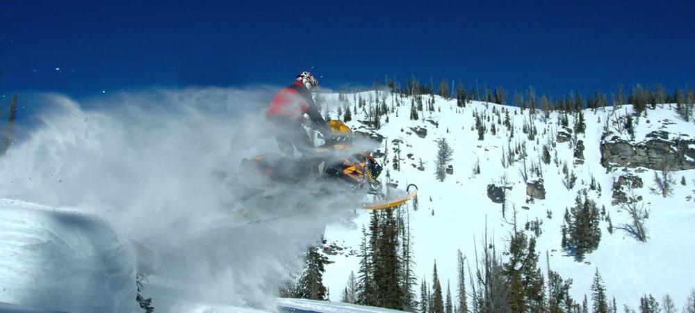 slide-snowmobile-jumping