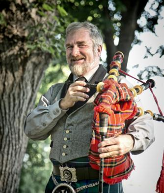 Man holding bagpipe at bitterroot celtic games