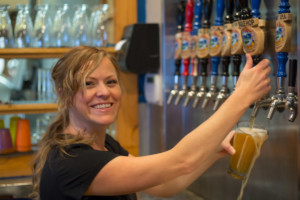 bartender pouring micro brew beer in hamilton montana