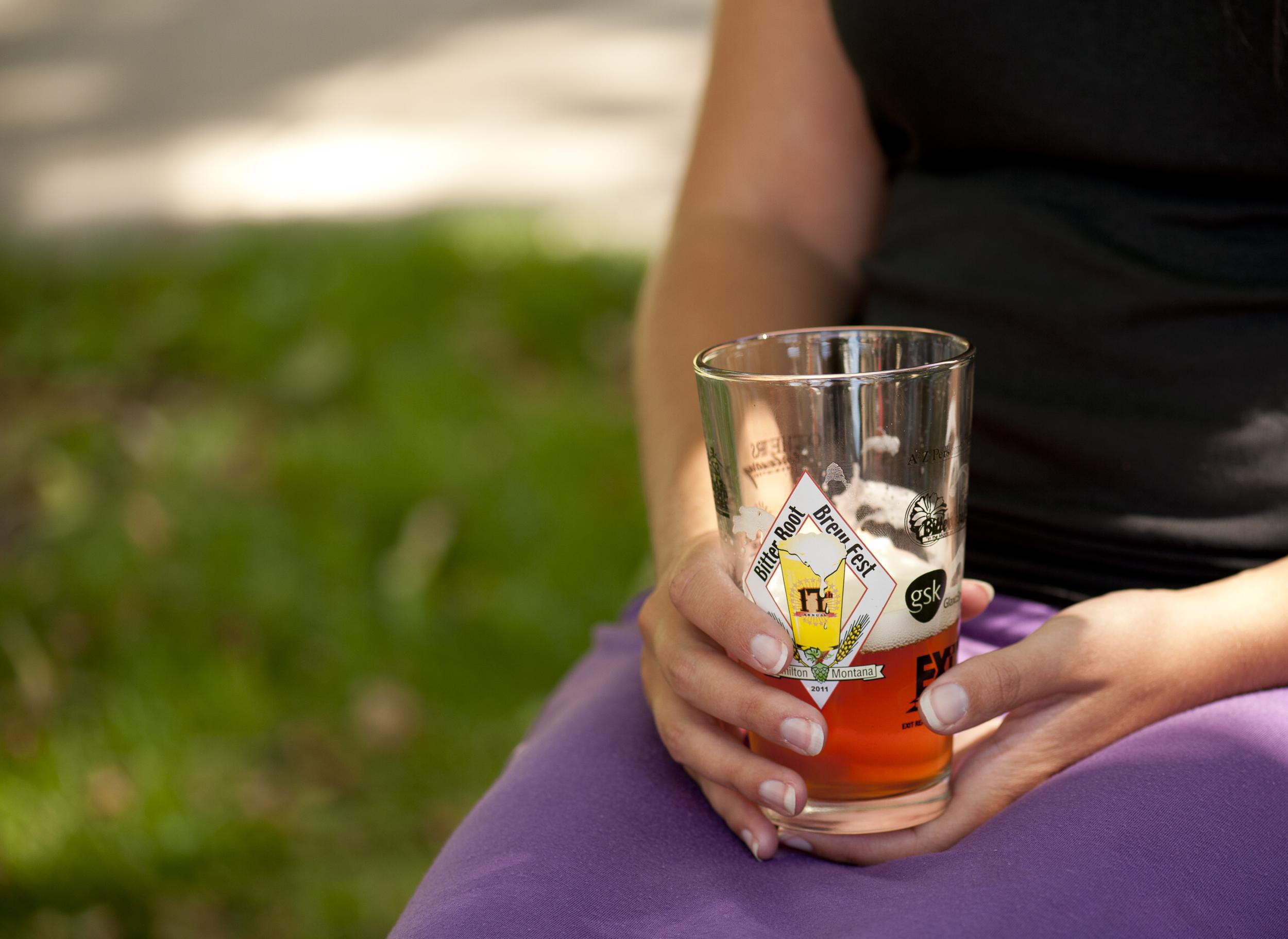 woman holding beer glass at hamilton, montana microbrew festival