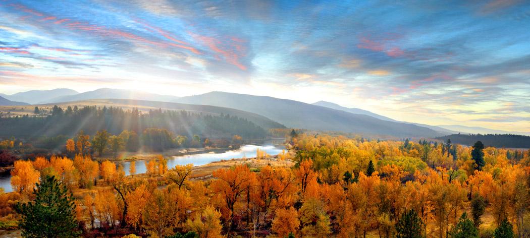 luxury bed & breakfast bitterroot valleyll panorama of bitterroot river and sapphire mountains, sun flare