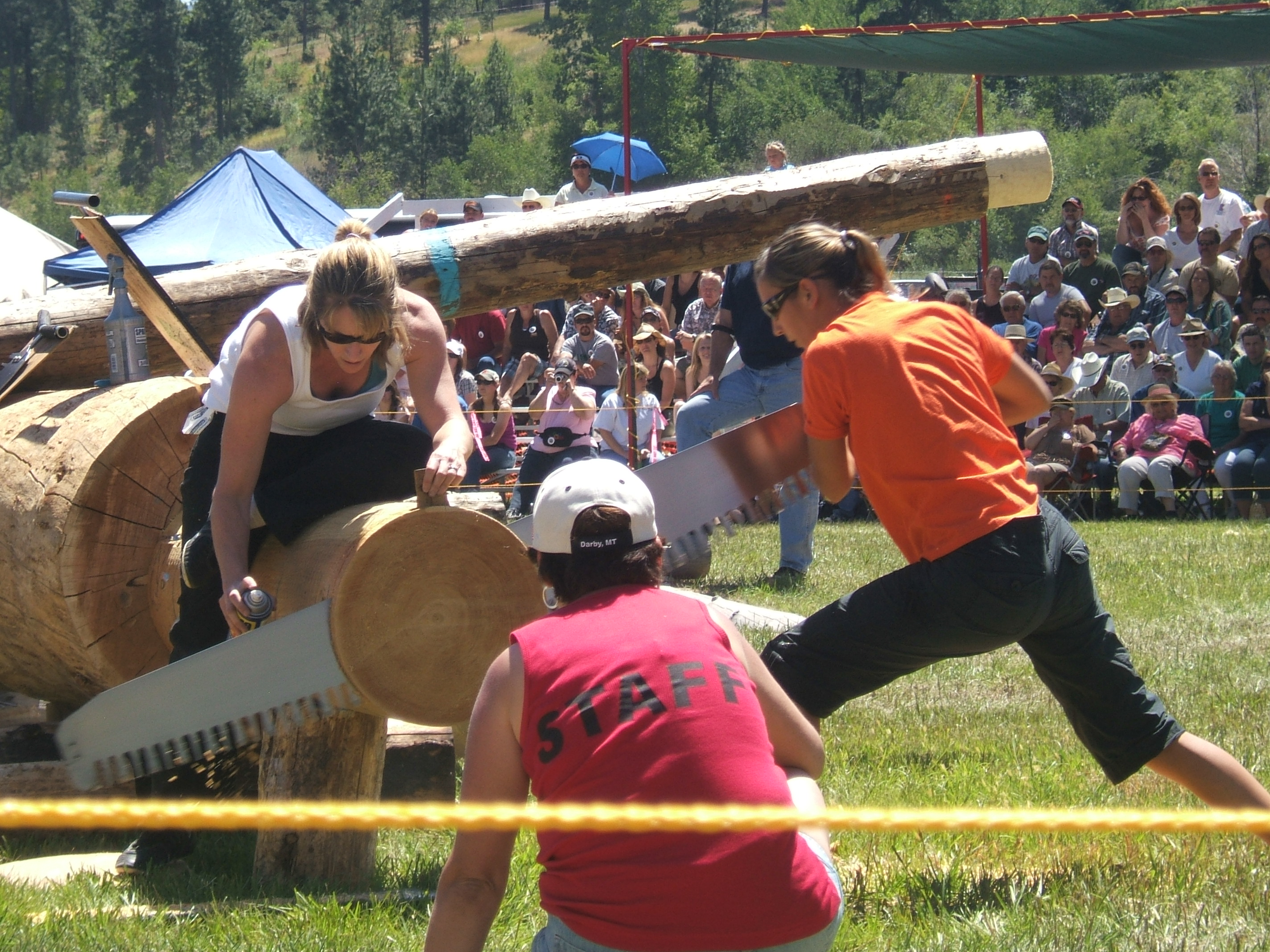 Women saw logs at Darby Logger Days
