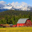 red barn with como peaks mountains in background