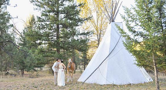 montana wedding couple with horse and teepee