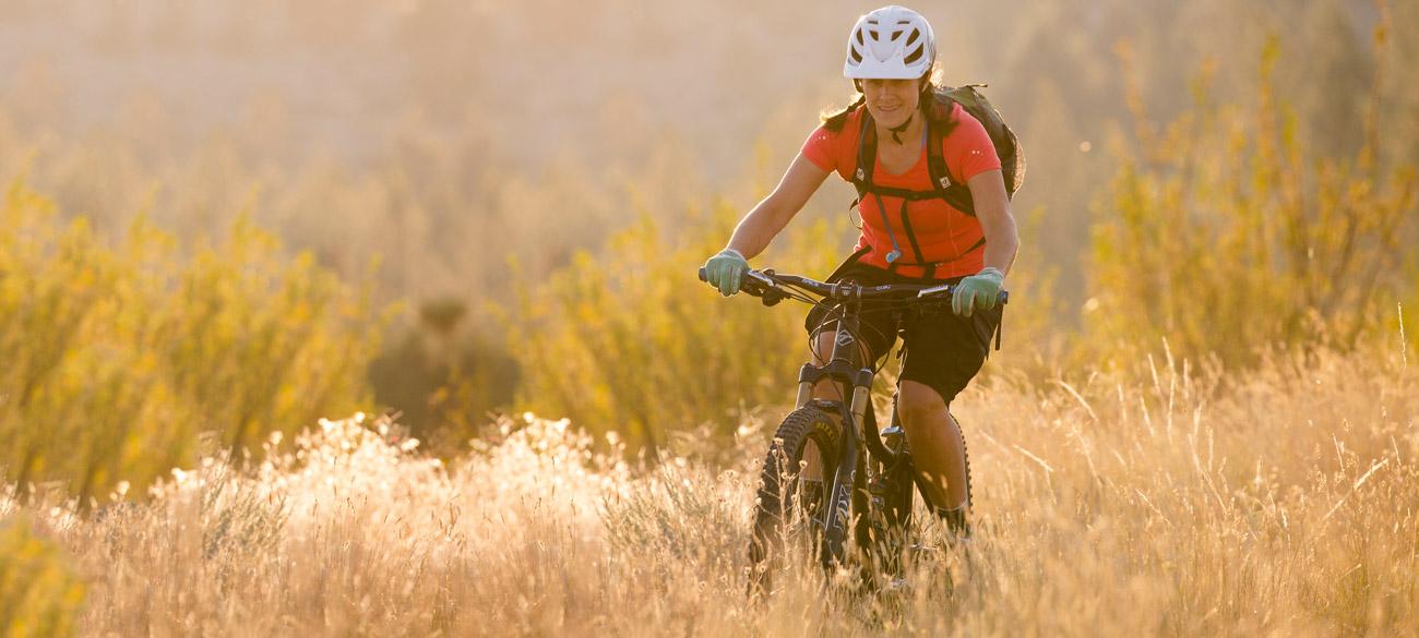 woman mountain biker in bitterroot valley montana