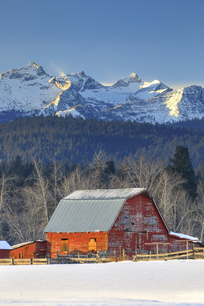 red barn with como peaks behind in snow