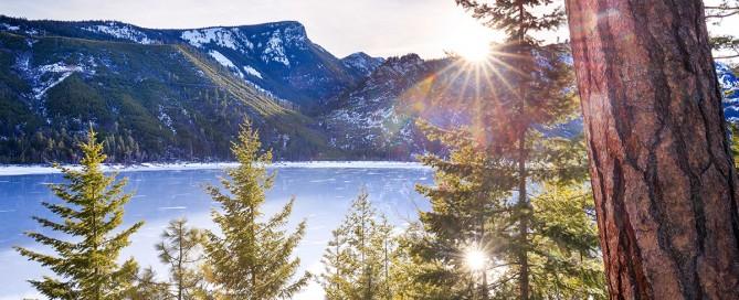 Lake Como Montana frozen in winter at sunset