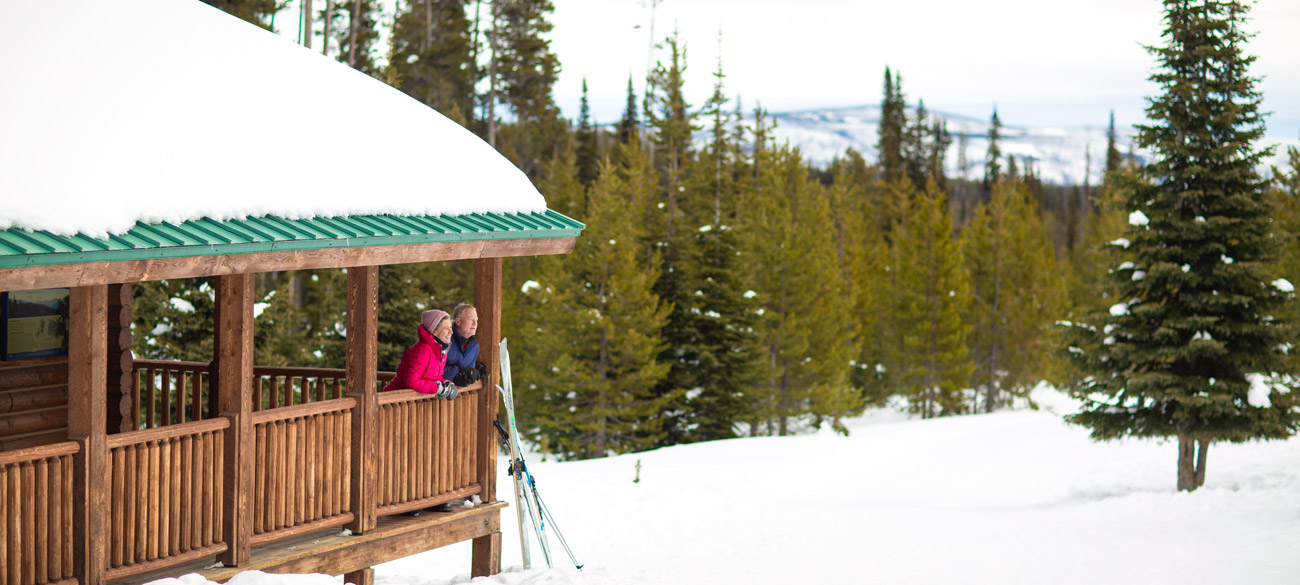 couple at cabin on continental divide with cross country skis