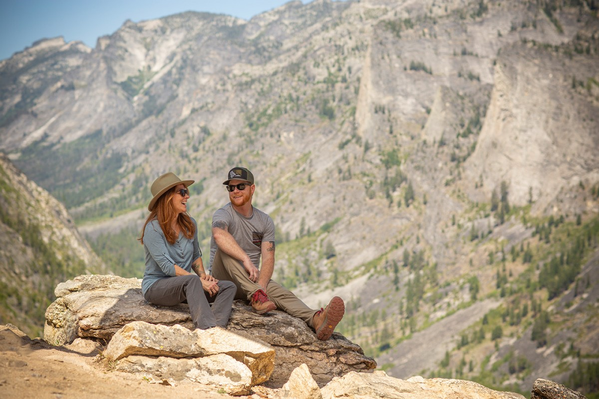 man and woman hikers sitting at blodgett canyon overlook